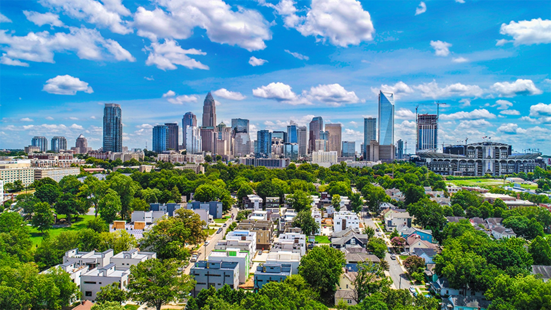 The skyline of Charlotte, NC, as a consortium of the public, private and non-profit sectors announce the launch of a comprehensive community-wide effort to create a strategic plan around housing instability and homelessness in the community.