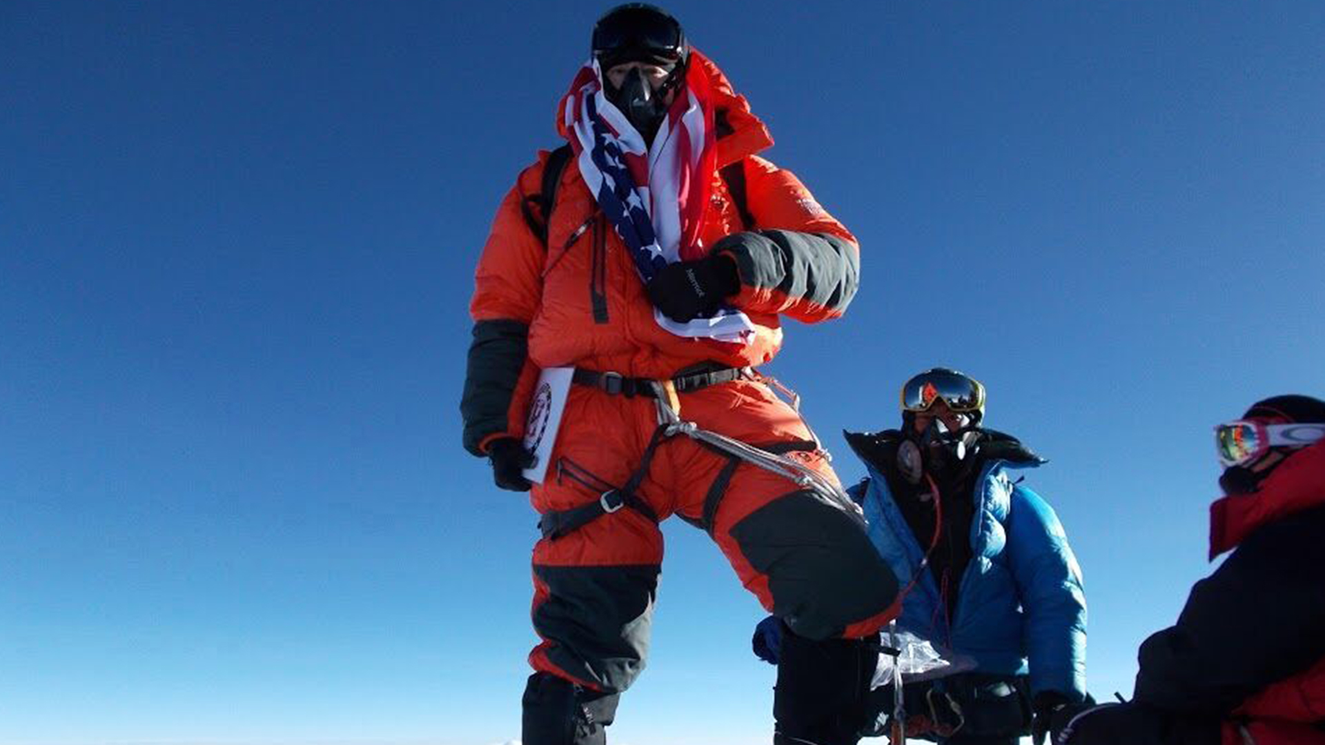Man on top of Mount Everest