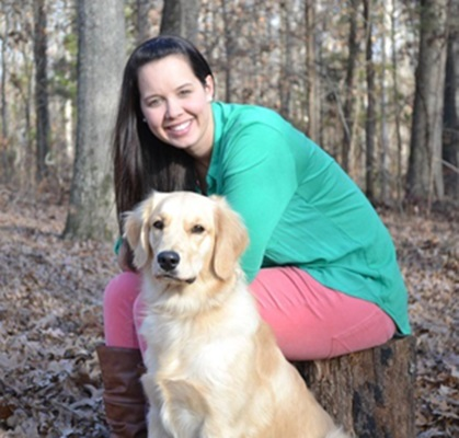 Christina Hall with her dog, Maggie, who serves as a therapy dog for LCH