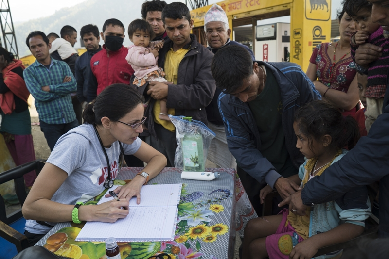 Carolinas Medical Centery-Mercy emergency physician Sapana Adhikari, left, logs notes on dozens of patients seeking care outside Kathmandu. Team Rubicon continues to identify outlying areas impacted by the quake that have yet to receive aid.