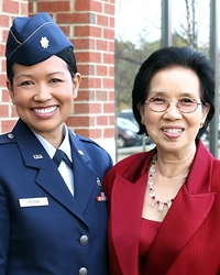 Paveena Posang, MD, emigrated with her mother (at right) and other siblings from Thailand in 1981. She later earned her nursing degree and became a doctor and served for four years in the U.S. Air Force.