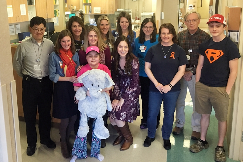 Madie with her family and her team of doctors and nurses at Levine Children's Hospital after a recent checkup.