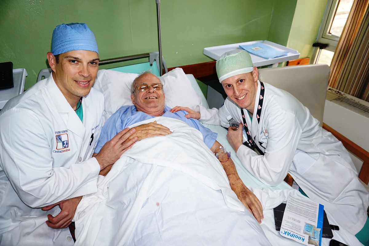 Operation Walk Carolinas founder Bryan Singer, MD (left), and Paul Coleman, PA, with a patient in Cuba.