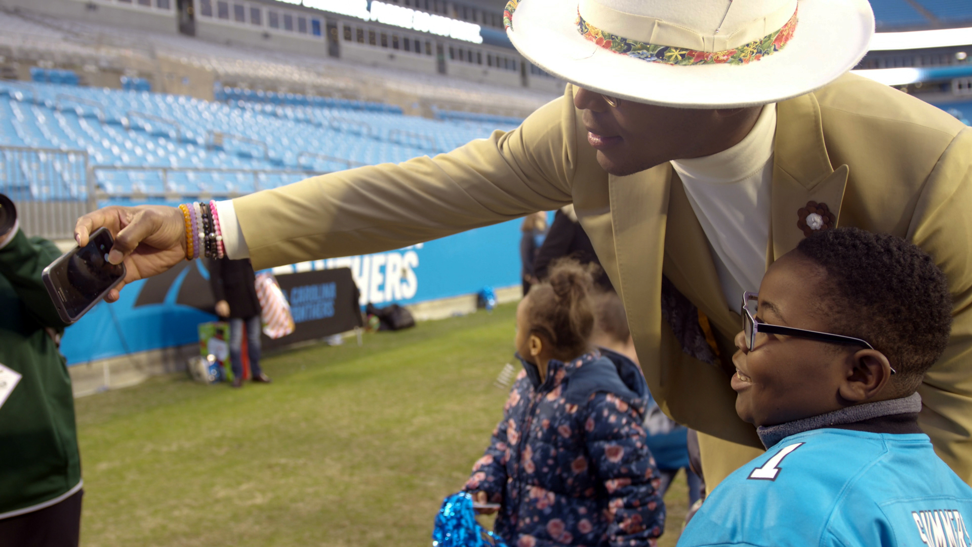 "For a few hours, a dozen patients at Atrium Health's Levine Children's Hospital and their families were able to forget about their worries and just enjoy a football game as special guests of Carolina Panthers' quarterback Cam Newton as part of his foundation's ""Christmas with Cam"" event."