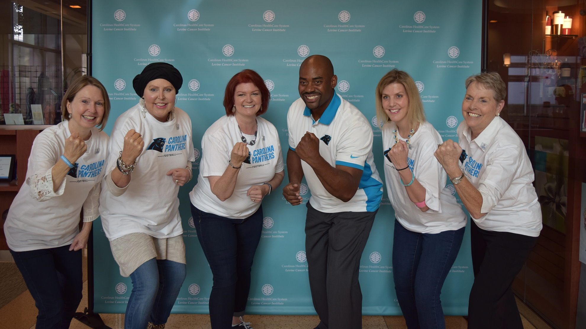 Former Carolina Panthers linebacker Chris Draft (third from right), met with lung cancer survivors at Levine Cancer Institute in Charlotte, N.C., as part of a vow he made to his late wife to support other survivors.